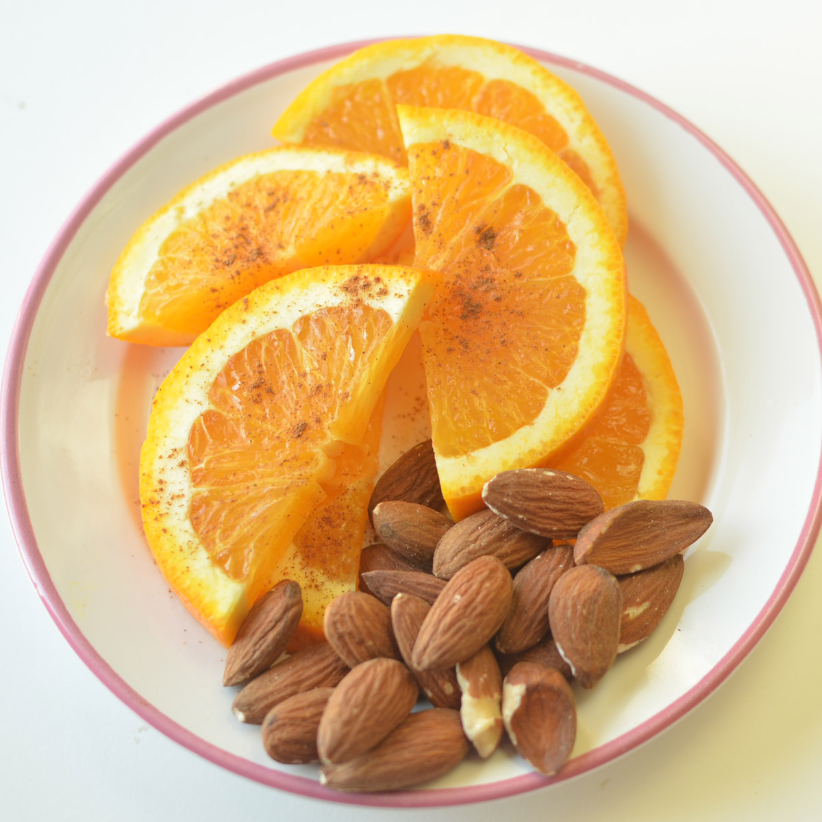 A Handful of Almonds With Half An Orange