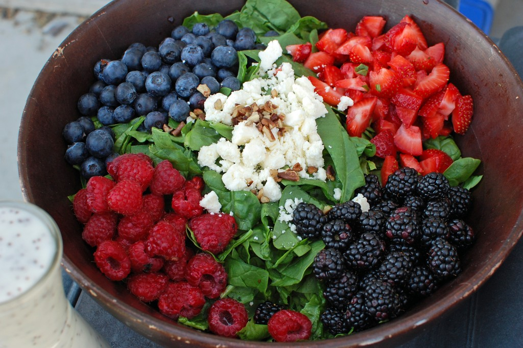 green salad with berries and feta
