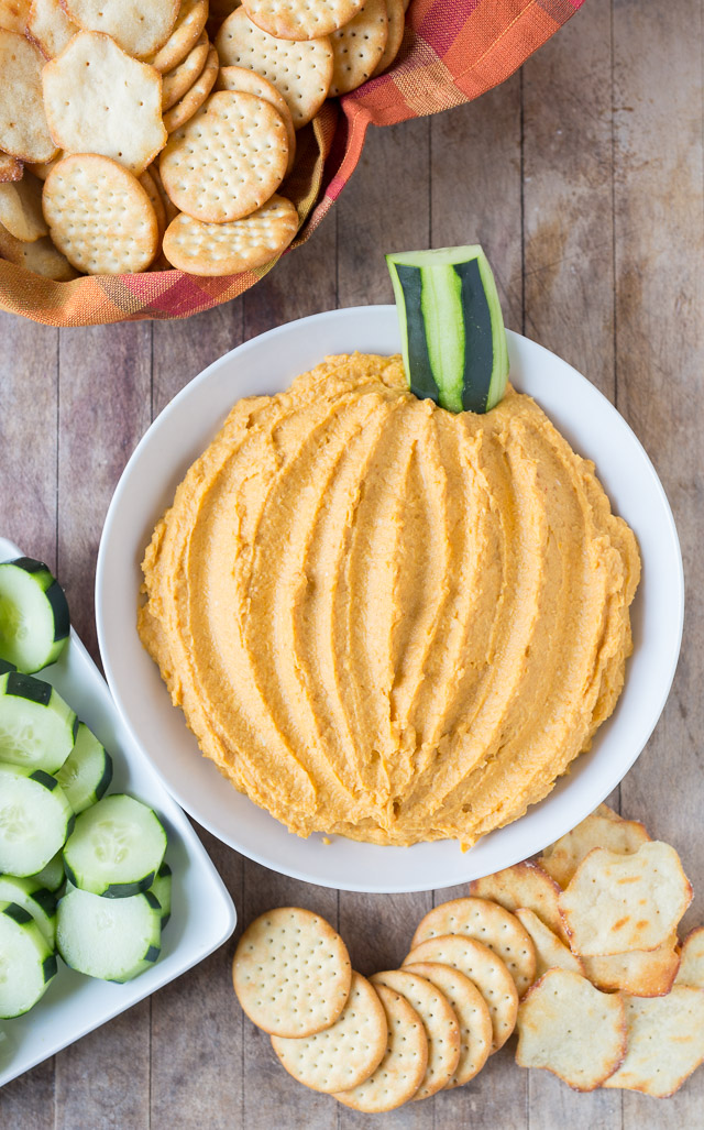 Pumpkin Hummus for Kids with cucumbers and crackers.