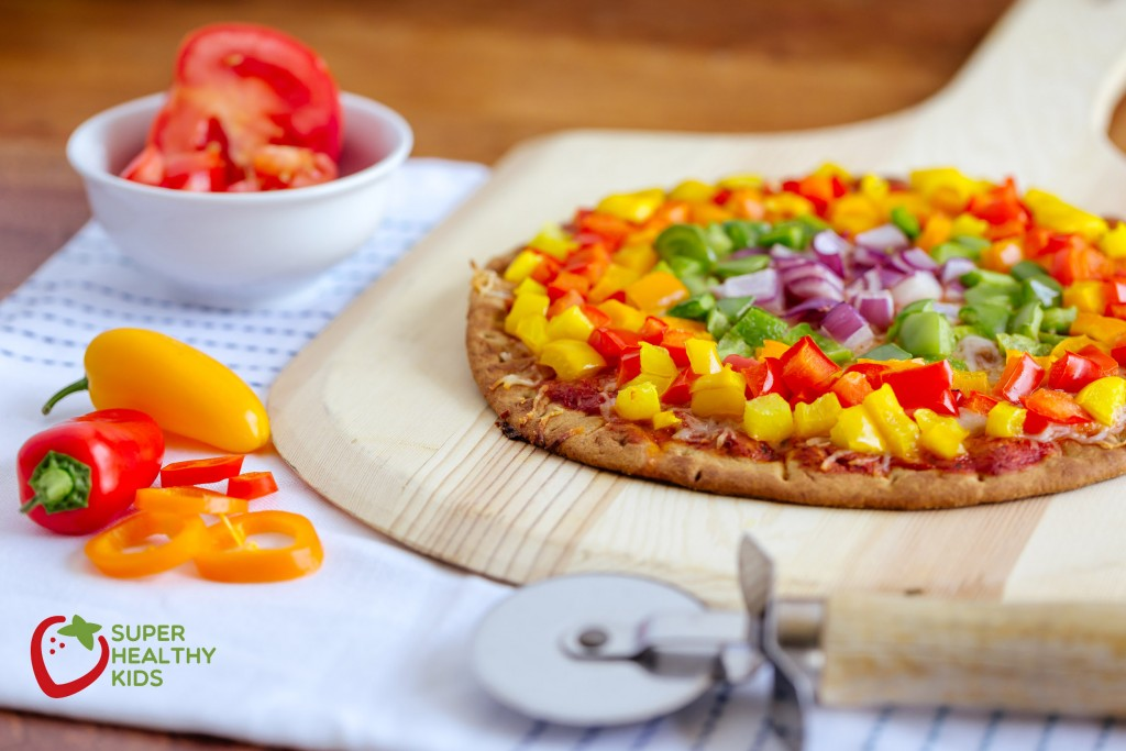 Rainbow Pepper Pizza. A great way to add nutrients to pizza...pile it with veggies!