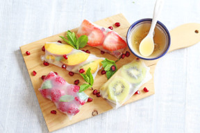 A delicious and tasty sweet twist on spring rolls, filled with fresh fruit and served with a honey lime dip