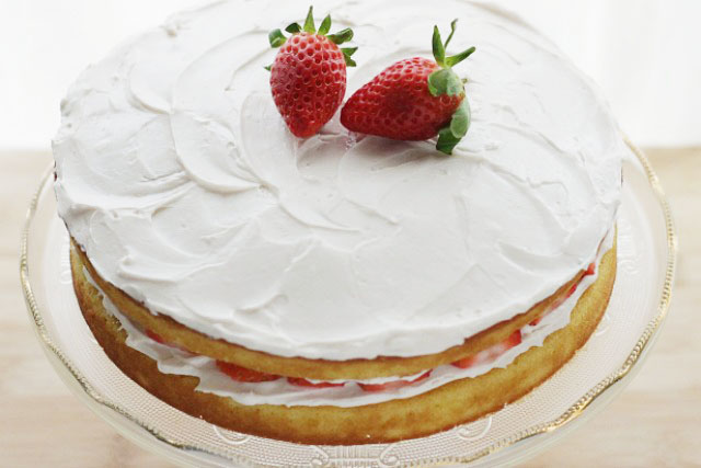 Low sugar lightened up moist vanilla cake with strawberry frosting. www.superhealthykids.com