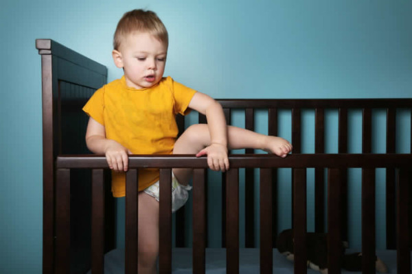 What to do when your child starts climbing out of their crib! Making the move from a crib to a bed. www.superhealthykids.com