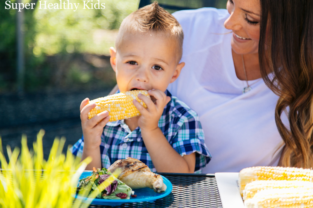 boy with corn from super healthy kids