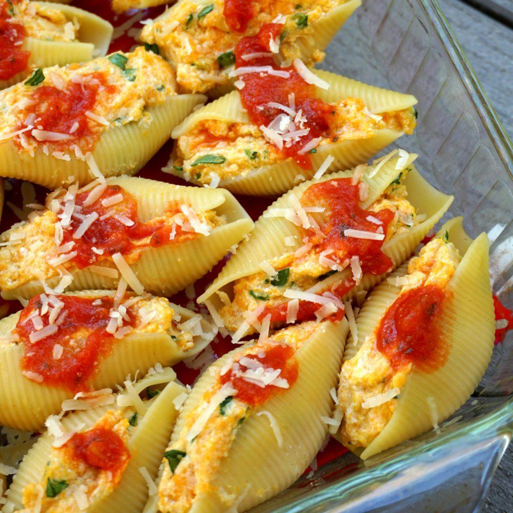 close up stuffed shells in baking dish