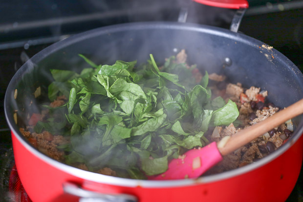 How to make Protein Packed Breakfast Burritos with spinach, meat cooking in a pan with spinach