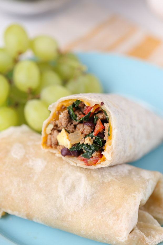 Protein Packed Breakfast Burritos for kids! with grapes in the background