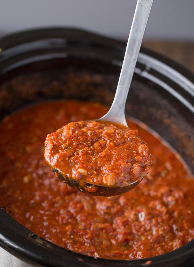 Slow Cooker Turkey Bolognese Recipe the whole family will love! sauce being scooped