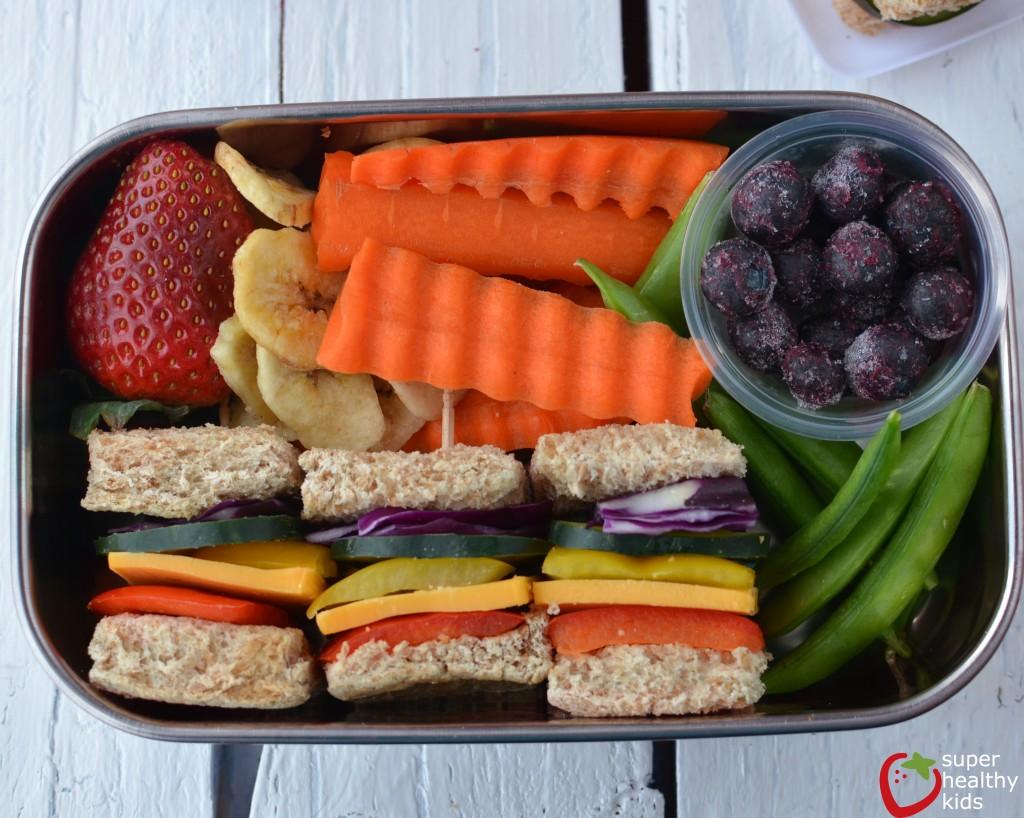 Lunch Box Idea: Mini Rainbow Sandwiches. Lunch box idea using a variety of fruits and veggies for mini sandwiches.