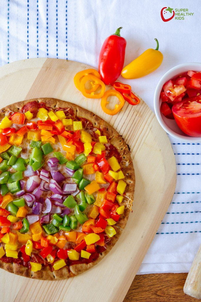 Rainbow Pepper Pizza. A great way to add nutrients to pizza...pile it with veggies! with bell peppers and red onions