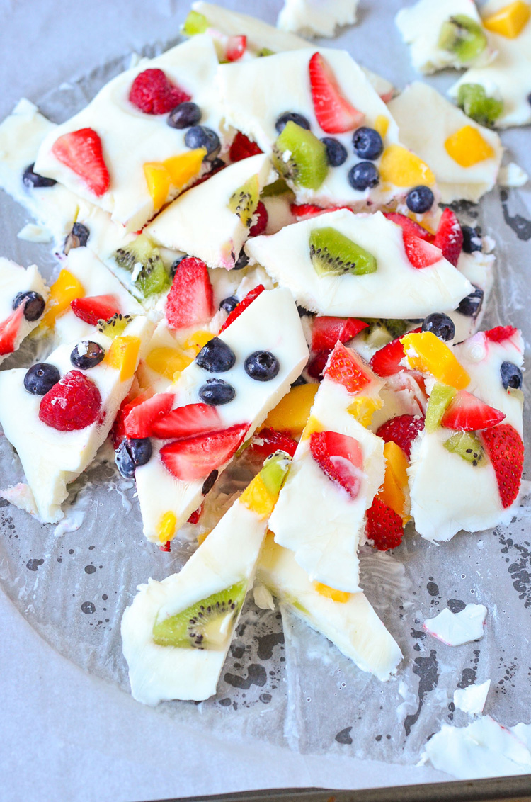 Strawberry Blueberry Frozen Yogurt Bark. A healthy and refreshing frozen treat for summer. Super easy to make, and a great thing to have in your freezer for an afternoon snack. www.superhealthykids.com