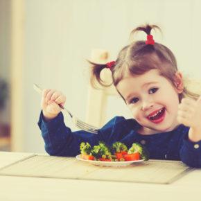 girl giving thumbs up for veggies