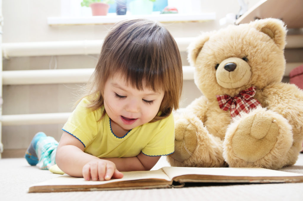 Girl reading a story that teaches nutrition