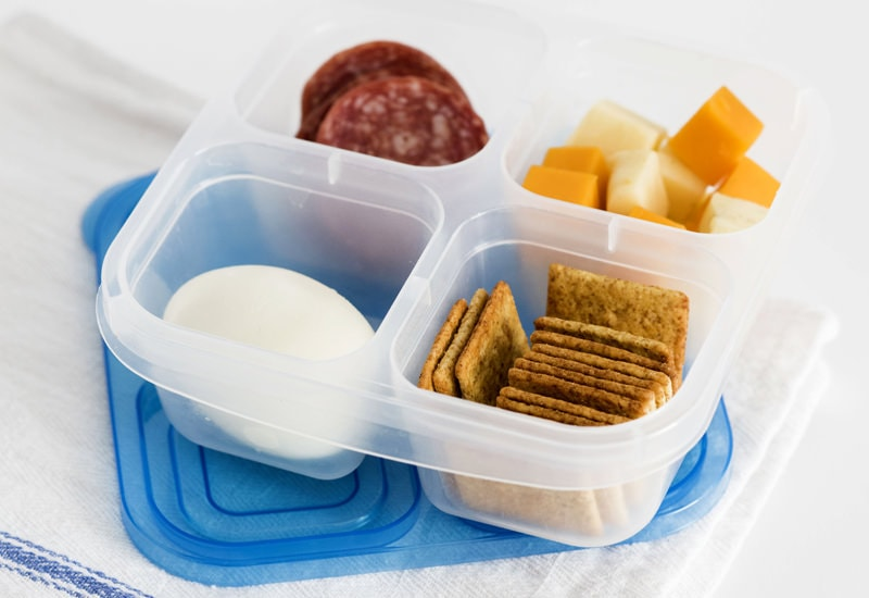 boiled egg, crackers, cheese cubes pepperoni in a snack box to take to a theme park