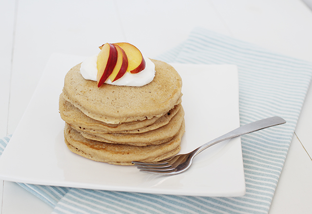 eggless pancakes with peaches on top