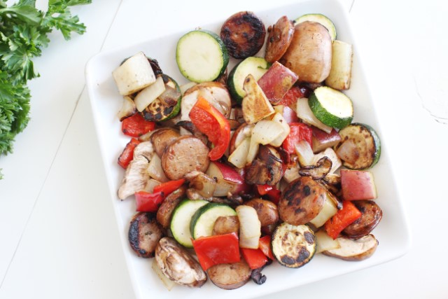 vegetables like zucchini in a sausage skillet